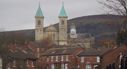 Hoy cross church and houses in Ardoyne
